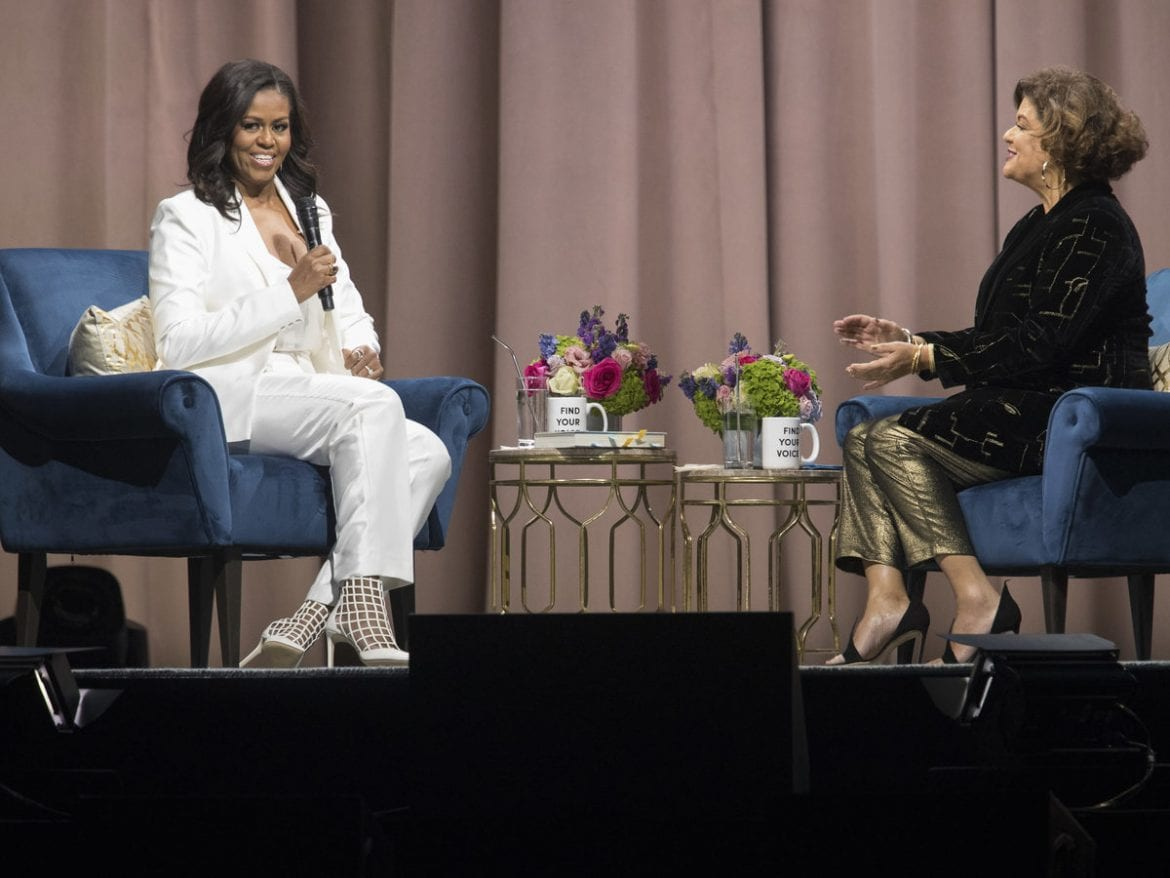 Former first lady Michelle Obama (left) talks with poet Elizabeth Alexander during an event for her memoir at Barclays Center on Saturday in Brooklyn, New York.