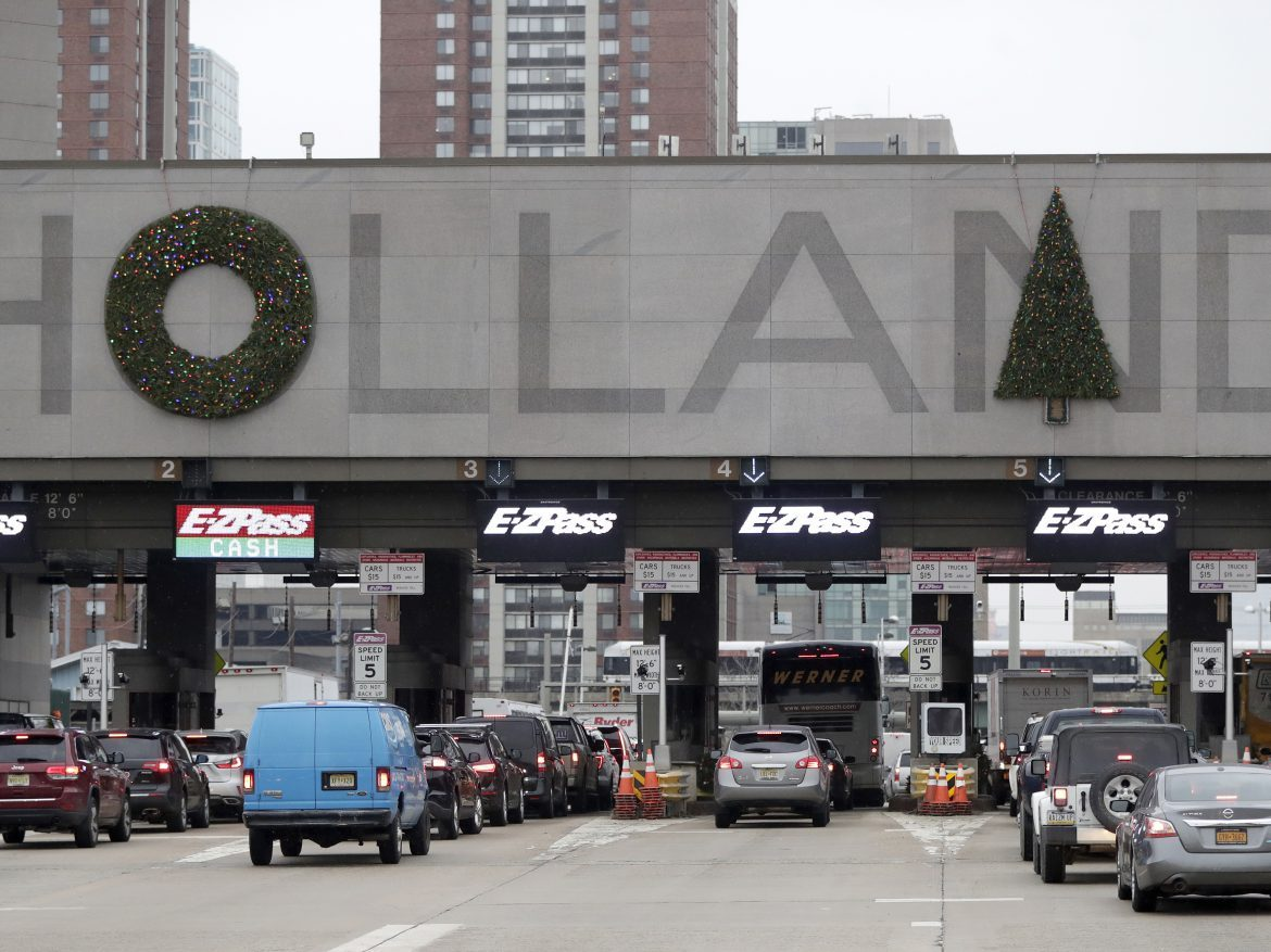 Holiday decorations adorn the letters on the toll booths at the Holland Tunnel last week in Jersey City.