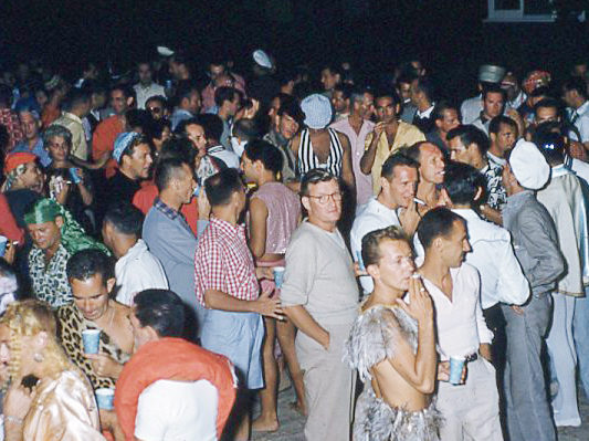 People attend a party in Cherry Grove section of Fire Island in New York during the 1960s.