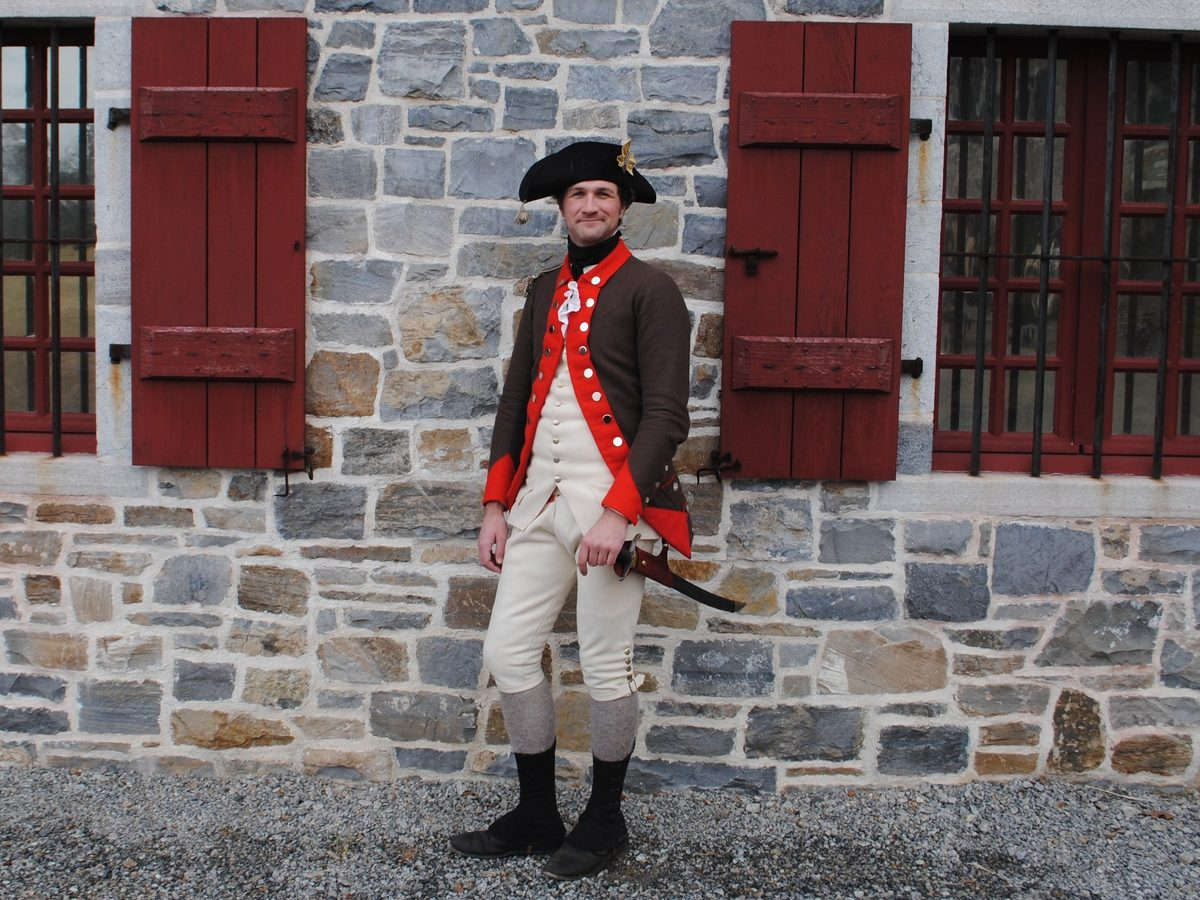 Matthew Keagle, a historian, re-enactor and lead curator at Fort Ticonderoga, wears a Continental Army officer's uniform that he made himself. He has uncovered new clues about the Christmas Riot of 1776 and what sparked the violence.