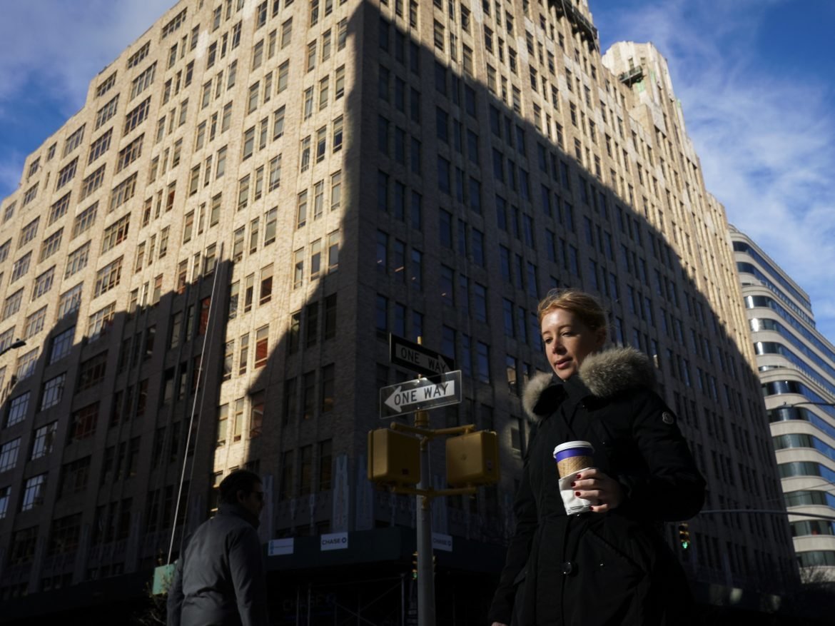 Google says it will lease office space at three spots in the West Village to create a new campus for thousands of workers in New York City. Here, a pedestrian passes by 345 Hudson Street, one of the buildings Google will be using.