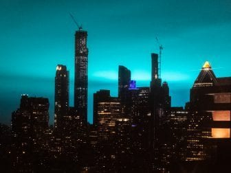 The night sky over New York City turned bright blue Thursday night, the result of a sustained electrical arc flash at an Astoria, Queens, power plant, according to Con Edison.