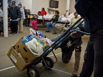Volunteers at the St. James Chapel Church food bank in Reading, Pa., hand out food and help the older and disabled.