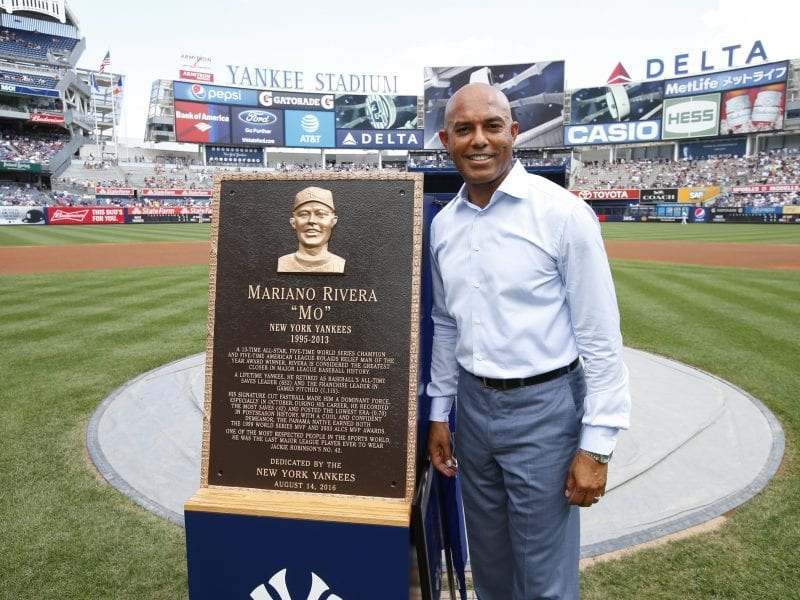 Former New York Yankees closer Mariano Rivera poses with his Monument Park plaque in 2016, at Yankee Stadium in New York.