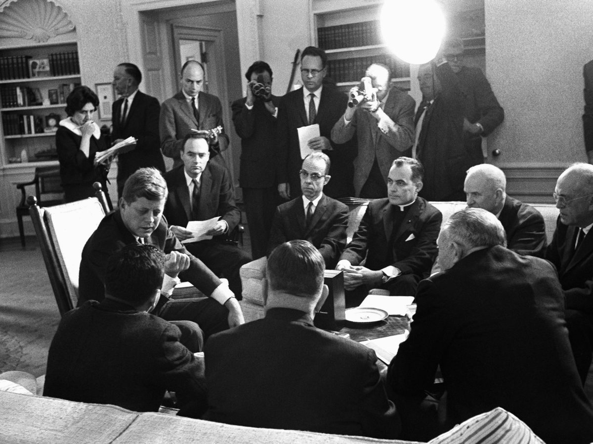President John F. Kennedy and members of the Civil Rights Commission pose during a White House conference in Washington in 1961. Harris Wofford, who died Monday at age 92, is seated to Kennedy's left.