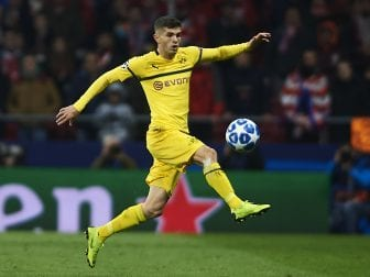 Chelsea FC will pay nearly $73 million to Borussia Dortmund for American soccer player Christian Pulisic. He is seen here in a Champions League match between Dortmund and Atlético Madrid in November.