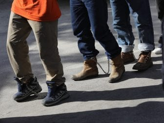 Unauthorized immigrants leave a court in shackles in McAllen, Texas. More than 40,000 immigration court hearings have been canceled since the government shut down.