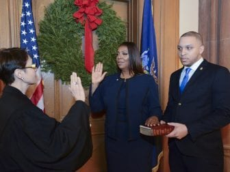 Letitia James (center) is sworn in as New York's 67th Attorney General in a ceremony Monday night at the state capitol in Albany. James is the state's first black attorney general, as well as the first woman to hold the state-wide elected office.