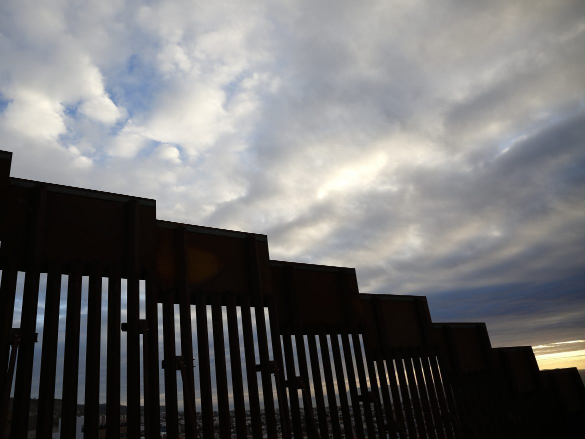A section of border wall separates Tijuana, Mexico, from San Diego, as seen from the U.S. in January. California has filed a lawsuit along with 15 other states, calling President Trump's use of a national emergency declaration to redirect money toward border wall construction unconstitutional.