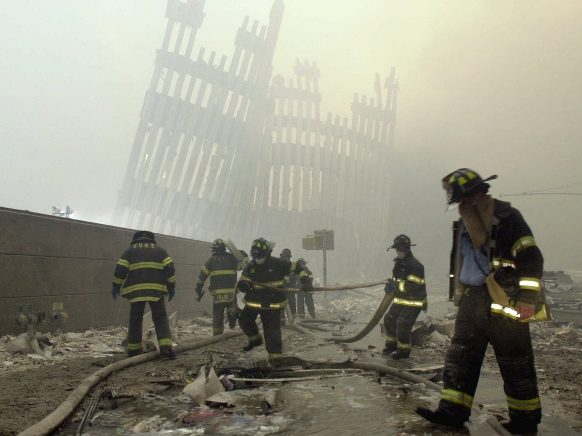 Firefighters work at Ground Zero, the site of the World Trade Center attacks, on Sept. 11, 2001.