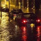 Vehicles sit in high floodwater during a storm surge associated with Superstorm Sandy in 2012, near the Brooklyn Battery Tunnel in New York.