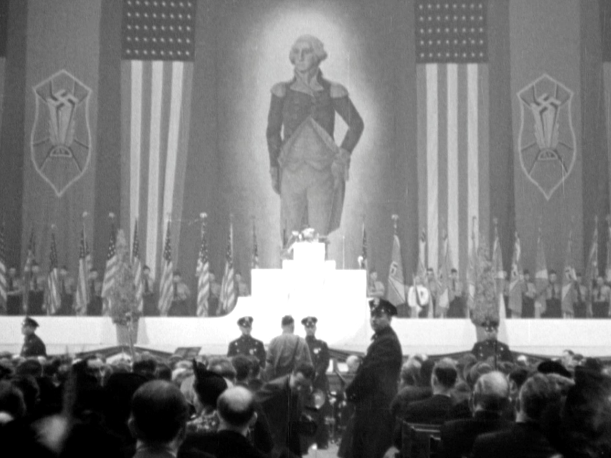 An enormous portrait of George Washington hangs alongside swastika banners and American flags at New York's Madison Square Garden in 1939 during the German American Bund's Pro-America Rally.