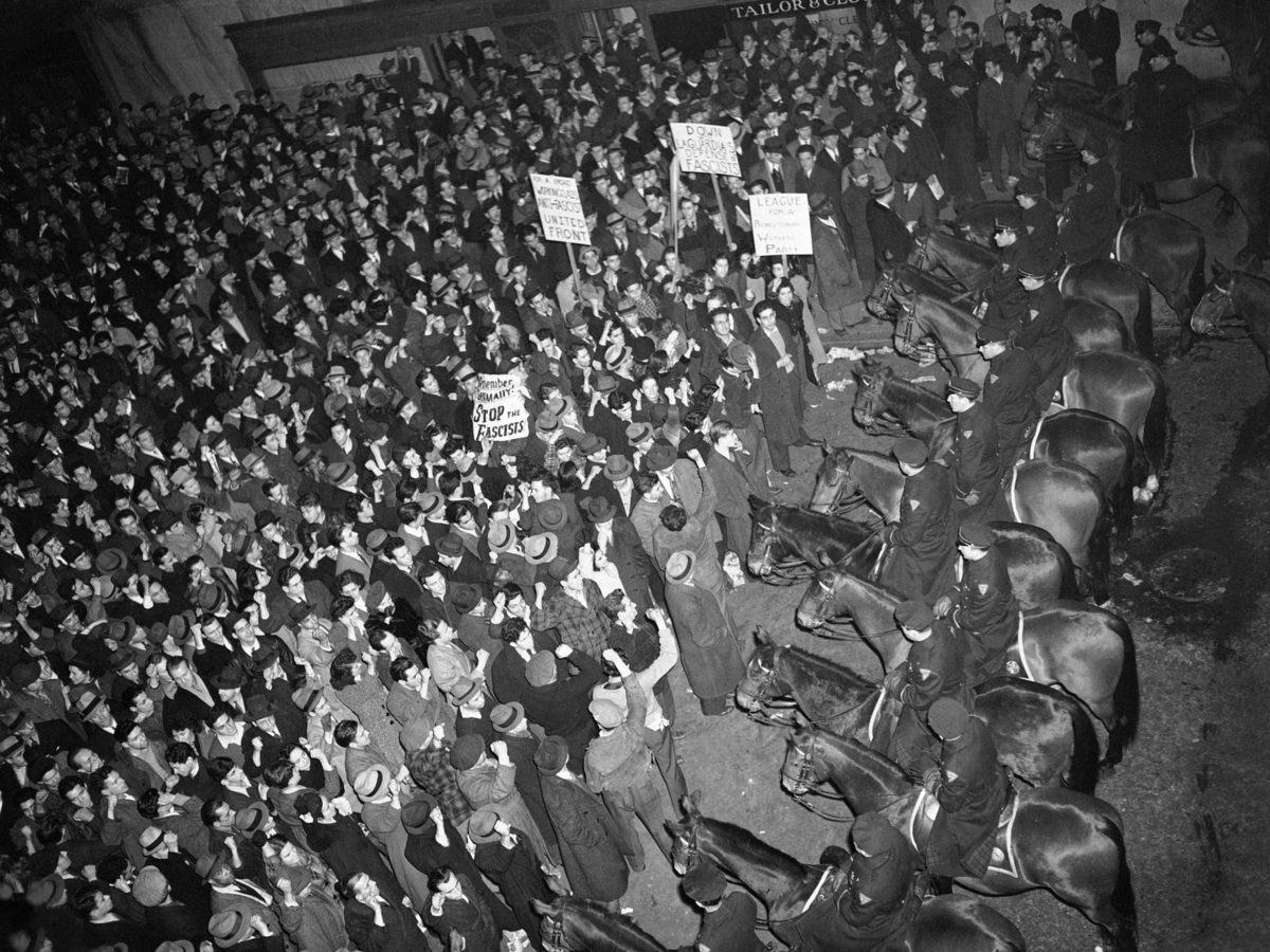 New York's mounted police form a solid line outside Madison Square Garden on Feb. 20, 1939, to hold in a crowd that had packed the streets around the venue where the fascist German American Bund was holding a rally.