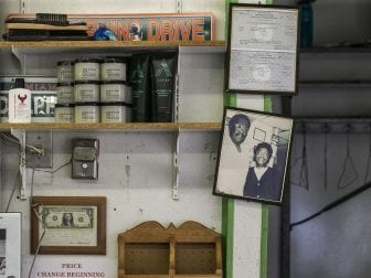 A 1980s photo of Carlton and Juanita Collins hangs inside the barbershop in the same spot it was taken.