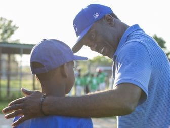 Charleston motivates Zion Singletary, 9, between innings.