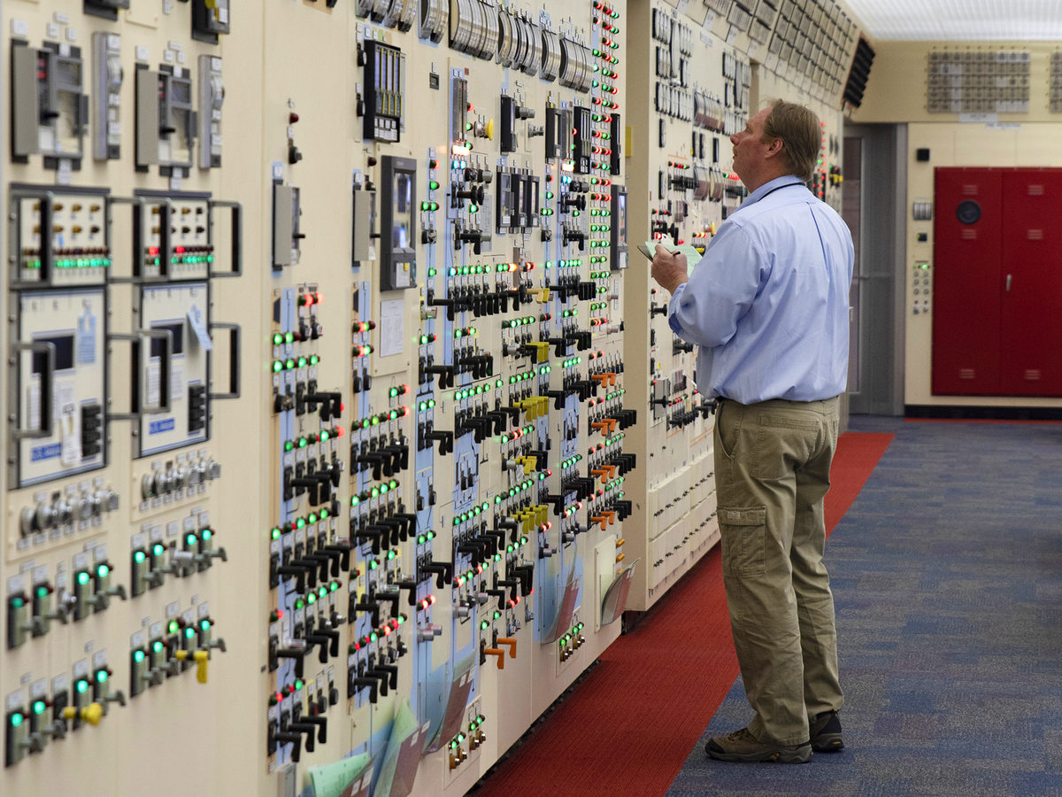A worker looks at a panel in the control center at Peach Bottom. The site is expanding its temporary storage to hold all the waste generated through the 60-years the plant is licensed to operate.