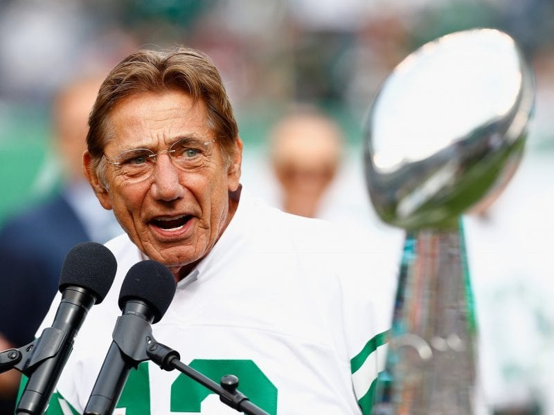 Joe Namath speaks at halftime of a New York Jets game in 2018. As quarterback, he led the Jets to a Super Bowl win and Vince Lombardi Trophy in 1969.