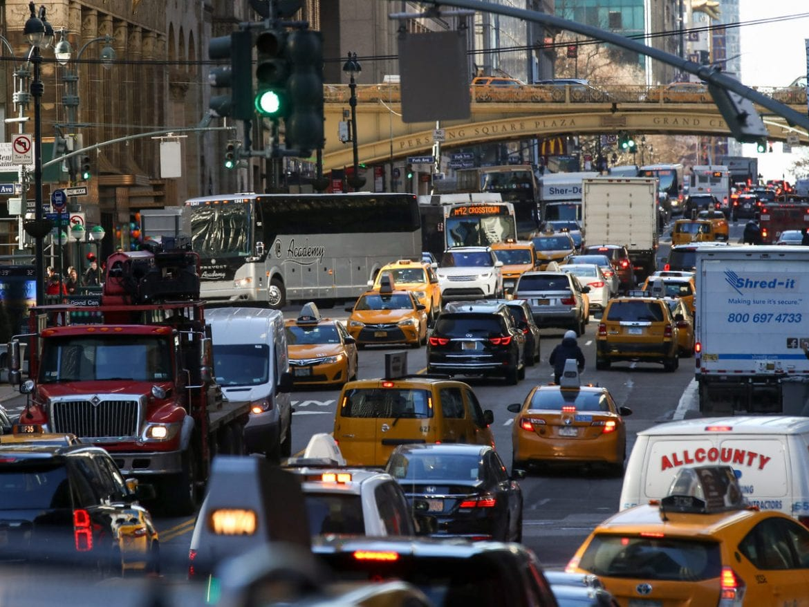 Traffic moves along 42nd Street in Midtown Manhattan on Jan. 25, 2018. After decades of efforts by transportation advocates, the state of New York has approved a plan to add congestion pricing to the city, charging drivers who enter a designated zone of Manhattan.