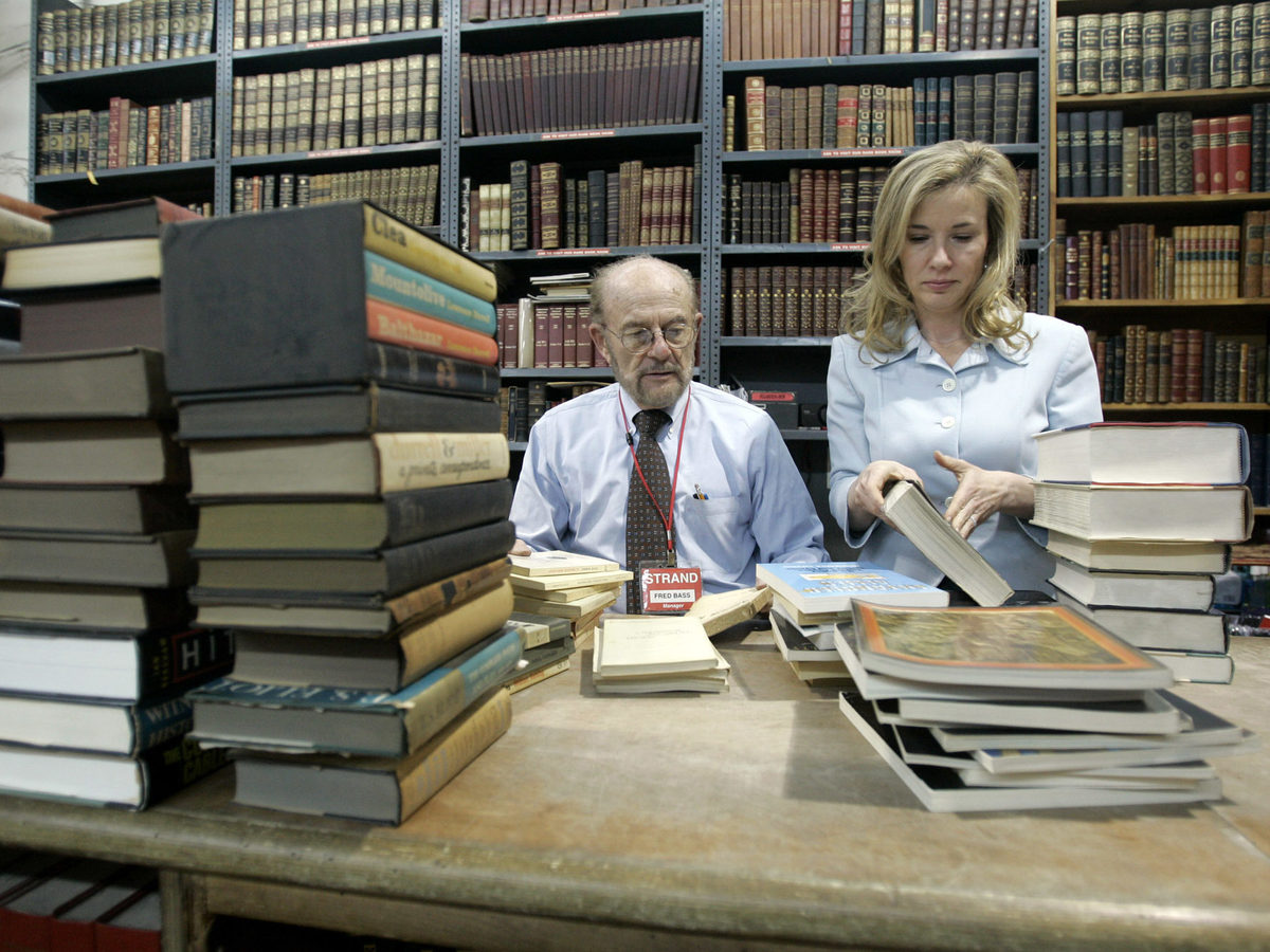 Nancy Bass Wyden and her father, Fred Bass, who died in 2018, sort used books at the Strand Bookstore in 2007. Bass Wyden's grandfather opened the store in 1927.