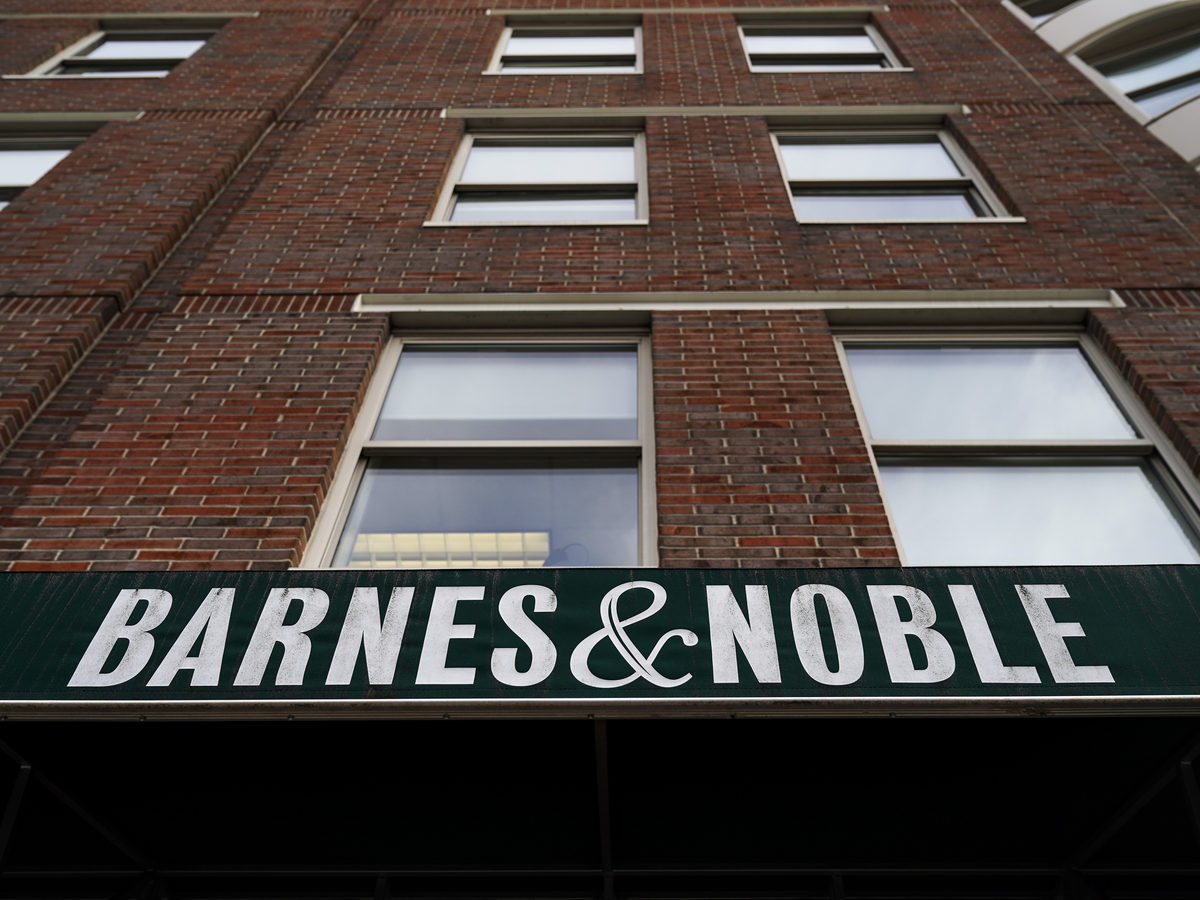 The sign for a Barnes & Noble bookstore hangs above the entrance to one of its locations in Brooklyn earlier this year. The book retailer and Elliott announced Friday that they have agreed to a sale price of about $683 million.