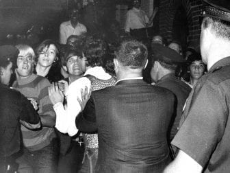 Stonewall Inn nightclub raid on June 28, 1969. The crowd attempts to impede police arrests.