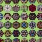 "Each of these vignettes required 37 ""hexies,"" little hexagonal scraps cut from donated neckties."