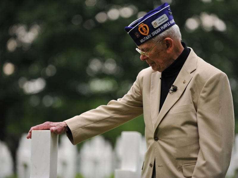 Leslie Cruise, a World War II veteran, pays his respects to Pvt. Richard Vargas during a wreath-laying ceremony at Lorraine American National Cemetery and Memorial, St. Avold, France, on June 2, 2014.