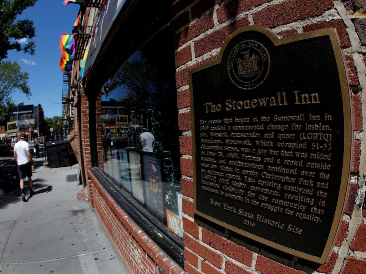 A man walks past New York's Stonewall Inn, site of the 1969 uprising considered the birth of LGBTQ movement.
