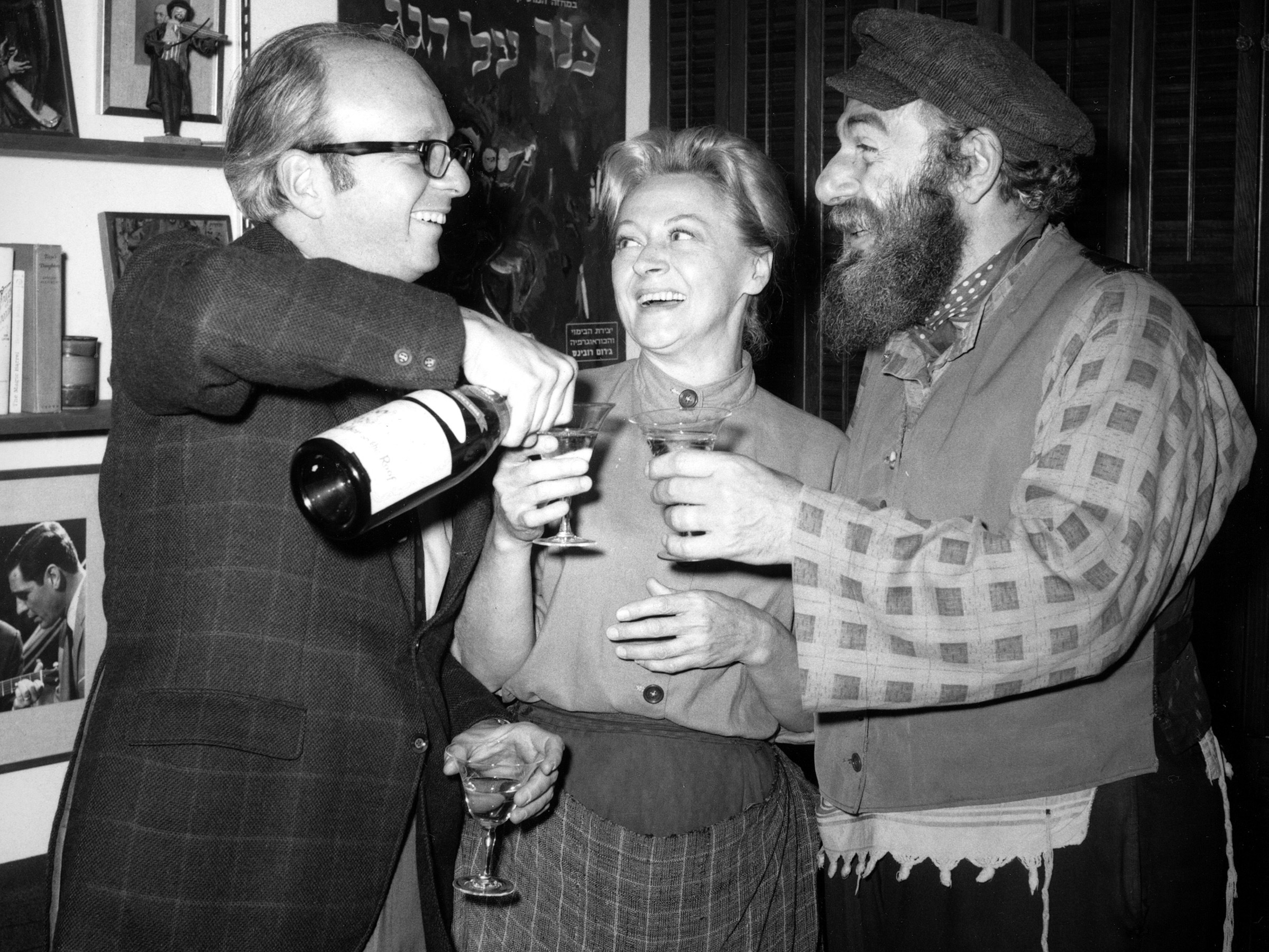 Producer Harold Prince celebrates the 1,254th sold-out performance of Fiddler On The Roof in 1967 with actors Maria Karnilova and Herschel Bernardi.