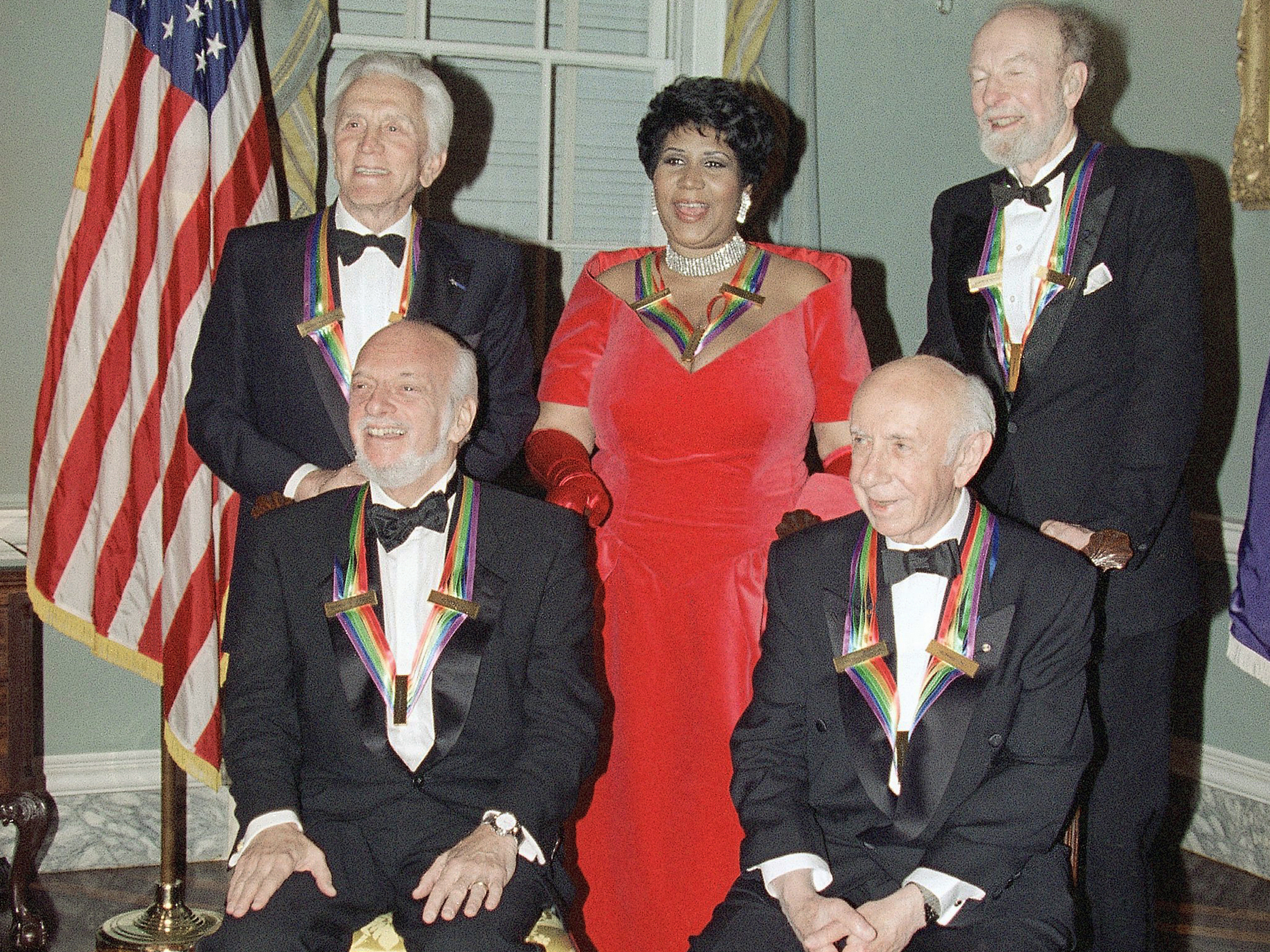 The 1994 recipients of the Kennedy Center Honors pose for a photograph. Hal Prince is seated on the left, next to Morton Gould. Standing, from left to right, are Kirk Douglas, Aretha Franklin and Pete Seeger.