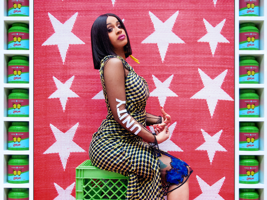Hassan Hajjaj, born in Morocco in 1961, is often called the Andy Warhol of Marrakesh for his fusion of glamour and everyday life. Both are evident in his 2017 portrait Cardi B Unity. The rap star, dressed in a high-fashion outfit, sits on utilitarian green plastic cartons against a textured fabric backdrop. The frame consists of tins of green tea, each decorated with a butterfly.