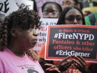 "Gwen Carr (left), mother of Eric Garner, joins a ""young people"" rally in Federal Plaza to protest the decision by federal prosecutors last month not to bring civil rights charges against New York City police Officer Daniel Pantaleo over Garner's death in 2014."