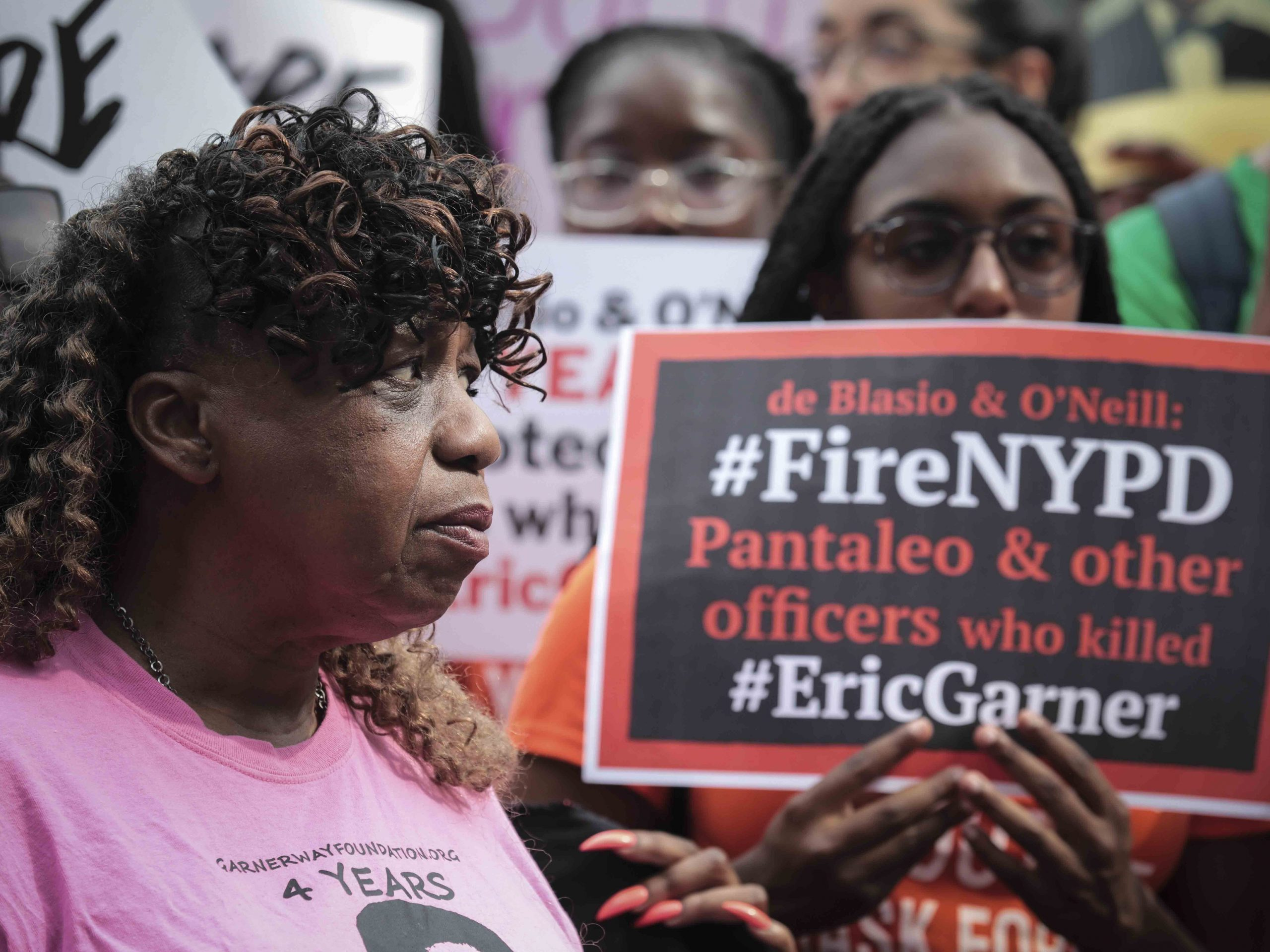 """Gwen Carr (left), mother of Eric Garner, joins a """"young people"""" rally in Federal Plaza to protest the decision by federal prosecutors last month not to bring civil rights charges against New York City police Officer Daniel Pantaleo over Garner's death in 2014."""
