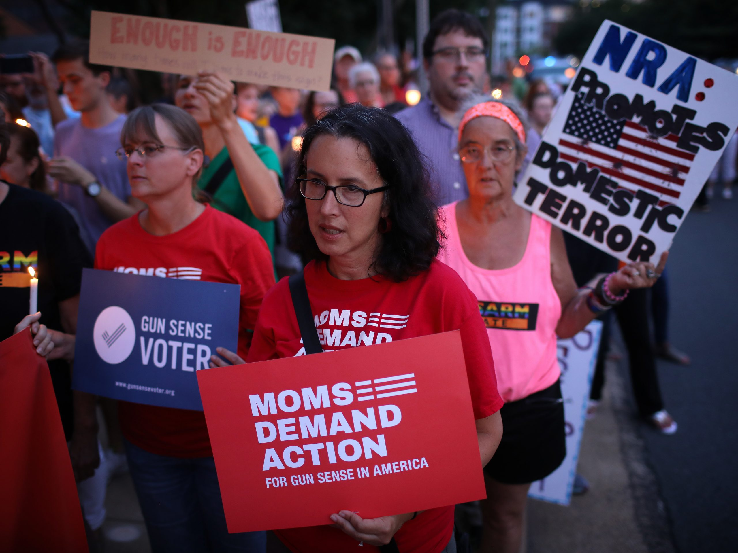 Advocates of stricter gun legislation hold a candlelight vigil for victims of recent mass shootings outside the headquarters of the National Rifle Association on Monday in Fairfax, Va.