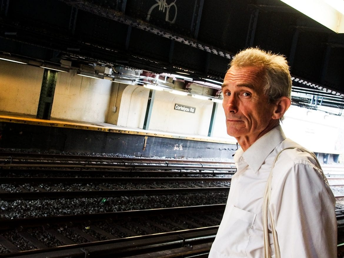 "Richard McLachlan, originally from New Zealand, waits for the Q train in Brooklyn. He delivers subway talks on the climate emergency, telling his fellow New Yorkers that they are ""sleepwalking into a catastrophe."""