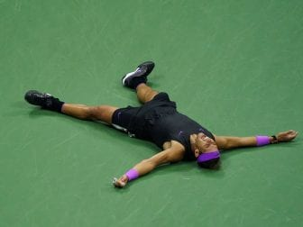 Rafael Nadal splays across the court after fending off a furious comeback attempt by Daniil Medvedev on Sunday. Nadal won the marathon match, but it took him five sets in New York City to do it: 7-5, 6-3, 5-7, 4-6, 6-4.