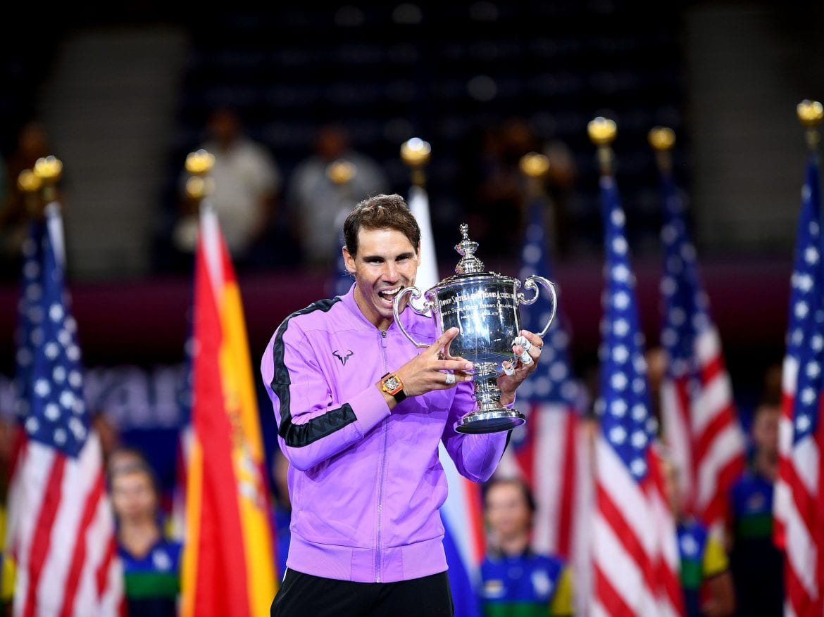 Rafael Nadal brandishes the spoils of his U.S. Open final victory over Russian Daniil Medvedev on Sunday. The Spaniard's win in New York City — his fourth U.S. Open title — gives him 19 career individual grand slam wins, just one shy of rival Roger Federer's record.