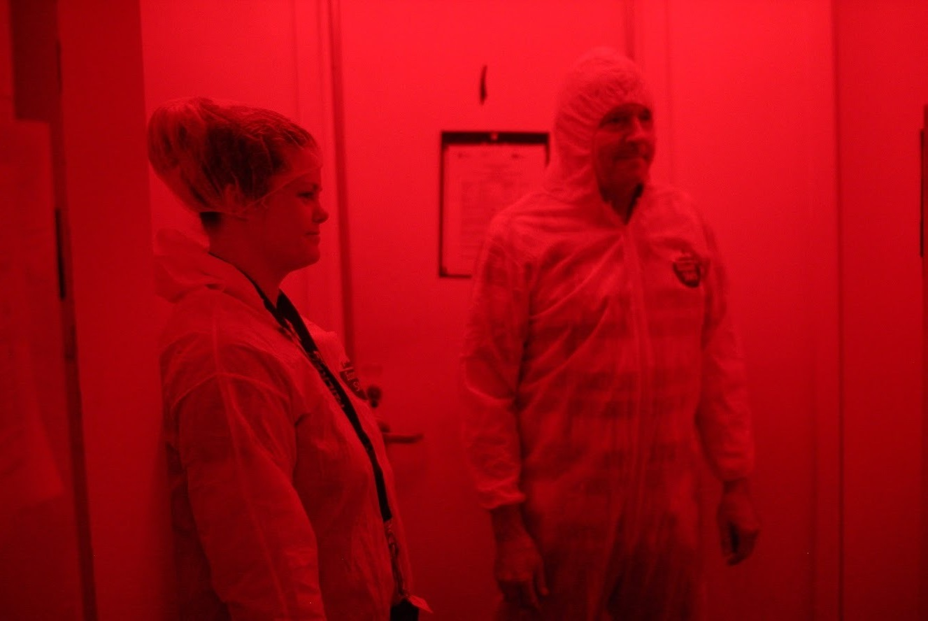 Amanda Stout and Kim Hoelmer, in the quarantine room at the USDA Beneficial Insects Introduction Research Unit in Newark, Delaware. The room uses red light because insects cannot sense it.