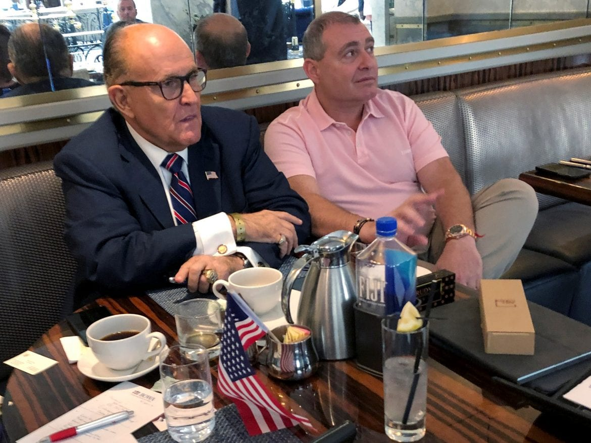 President Trump's personal lawyer Rudy Giuliani has coffee with Ukrainian-American businessman Lev Parnas at the Trump International Hotel in Washington on Sept. 20.