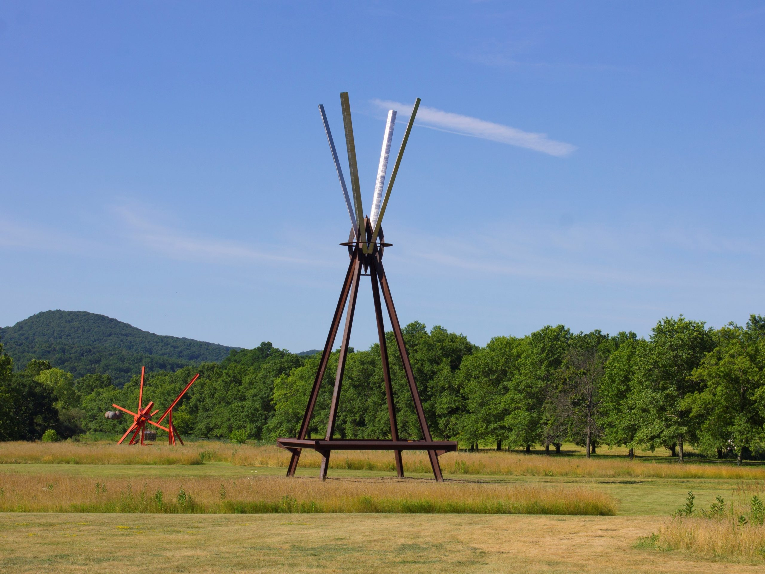 View of the south fields, all works by Mark di Suvero. Left to right: Figolu, 2005–11. Courtesy the artist and Spacetime C.C. E=MC2 , 1996-97. Courtesy the artist and Spacetime C.C. ©Mark di Suvero.