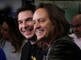Sprint CEO Marcelo Claure (left) and T-Mobile CEO John Legere on the floor of the New York Stock Exchange on April 30, 2018.