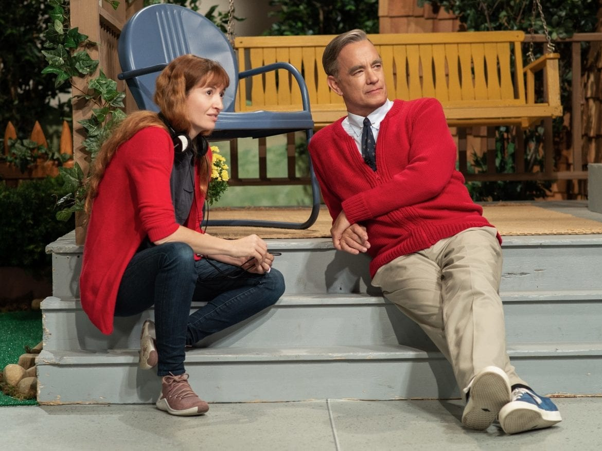 """The way the public feels about Tom Hanks has a similar quality to how we feel about Mister Rogers,"" says director Marielle Heller. But she found that Hanks and Rogers had a very different energy. At the beginning, she tried to ""rein Tom's natural buoyancy back and settle him into a kind of zenlike state."""