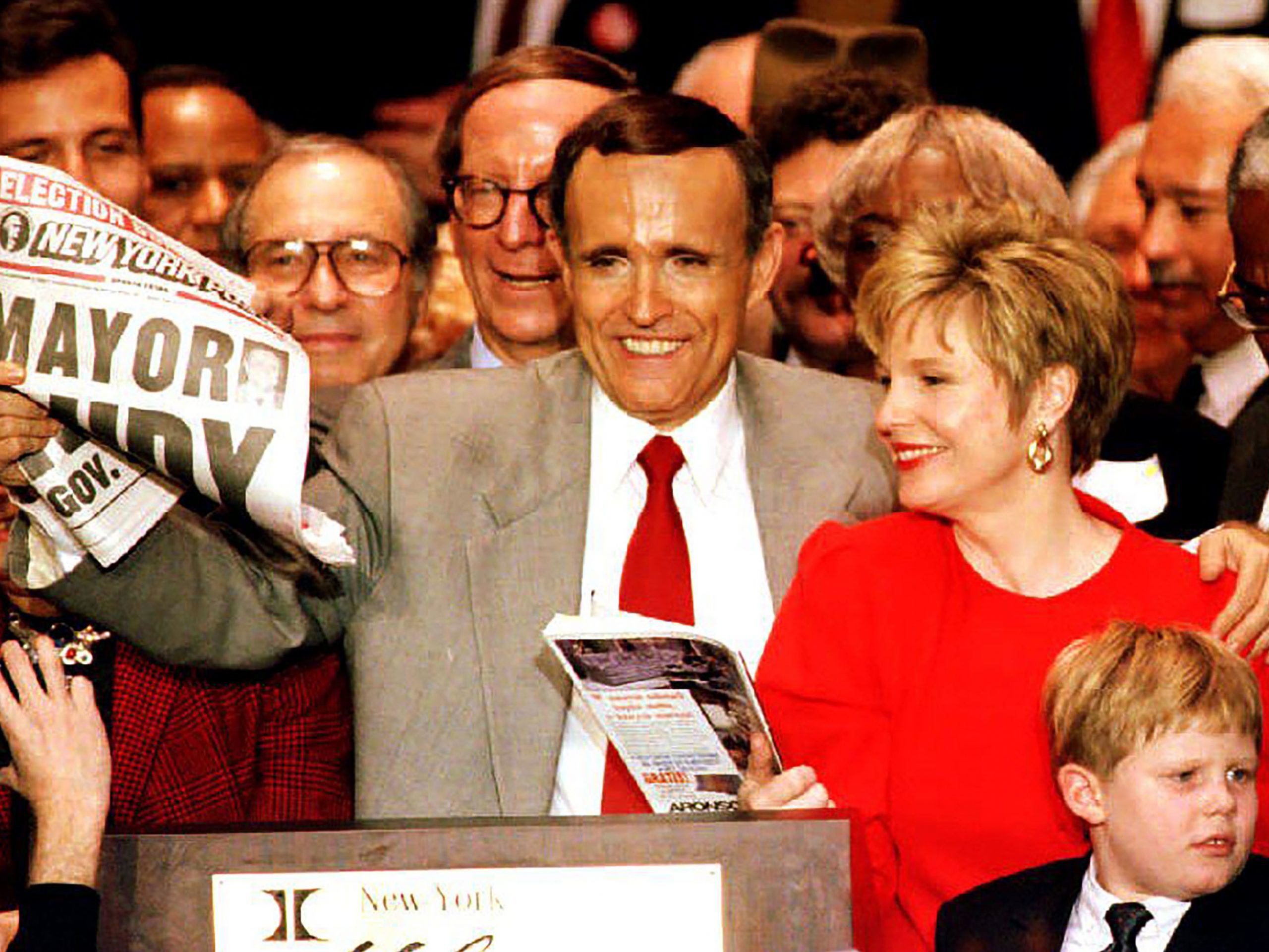 Mayor-elect Rudolph Giuliani holds a newspaper proclaiming him the mayor of New York after winning a tight race against Democratic incumbent David Dinkins in 1993.