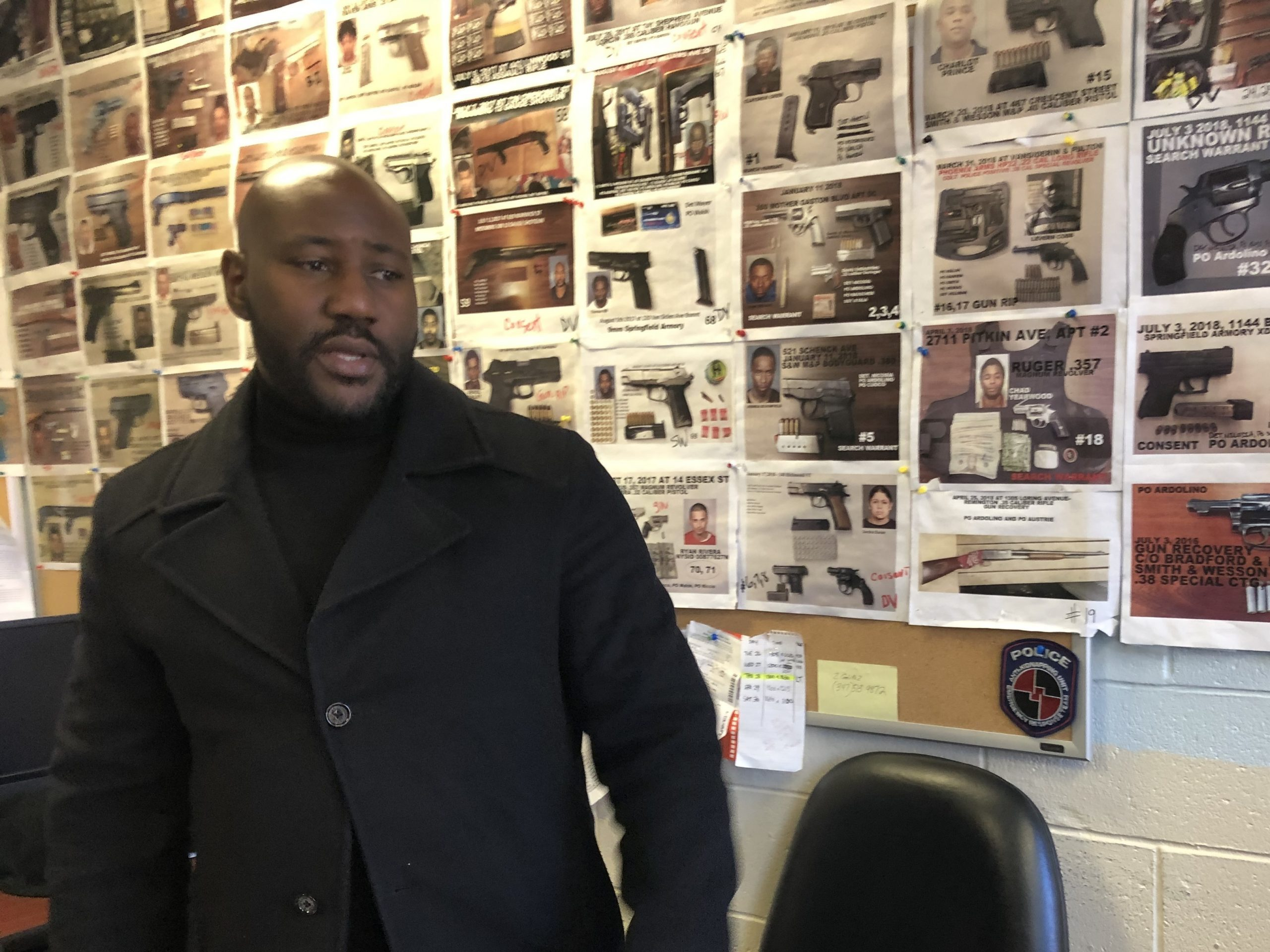New York police Sgt. Damon Martin in the 75th Precinct field intelligence office, where the walls are covered with photos of seized illegal guns.