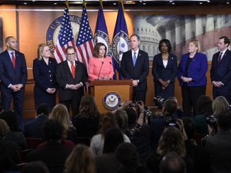 House Speaker Nancy Pelosi of California announces the seven impeachment managers — (flanking Pelosi from left) Hakeem Jeffries, Sylvia Garcia, Jerry Nadler, Adam Schiff, Val Demings, Zoe Lofgren Jason Crow — on Capitol Hill on Wednesday.