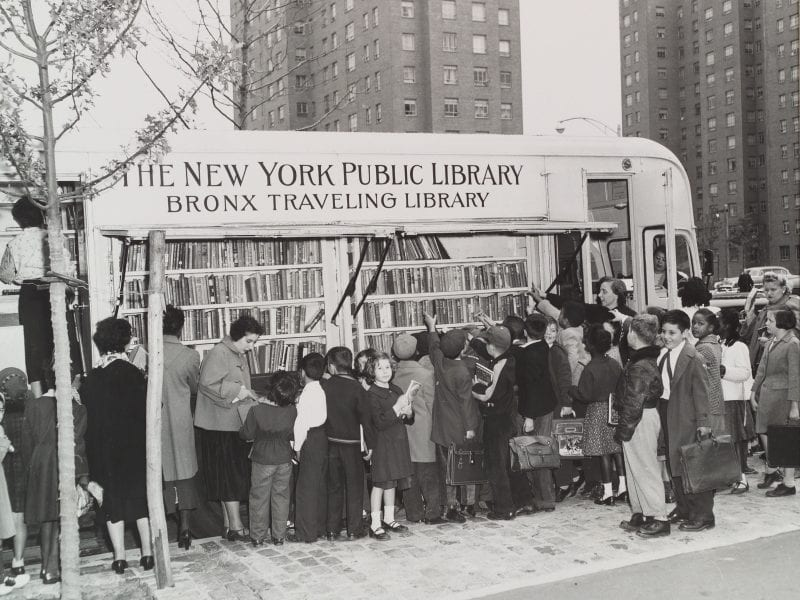 Children in the Bronx visit a New York Public Library bookmobile in the 1950s. The institution turns 125 this year.