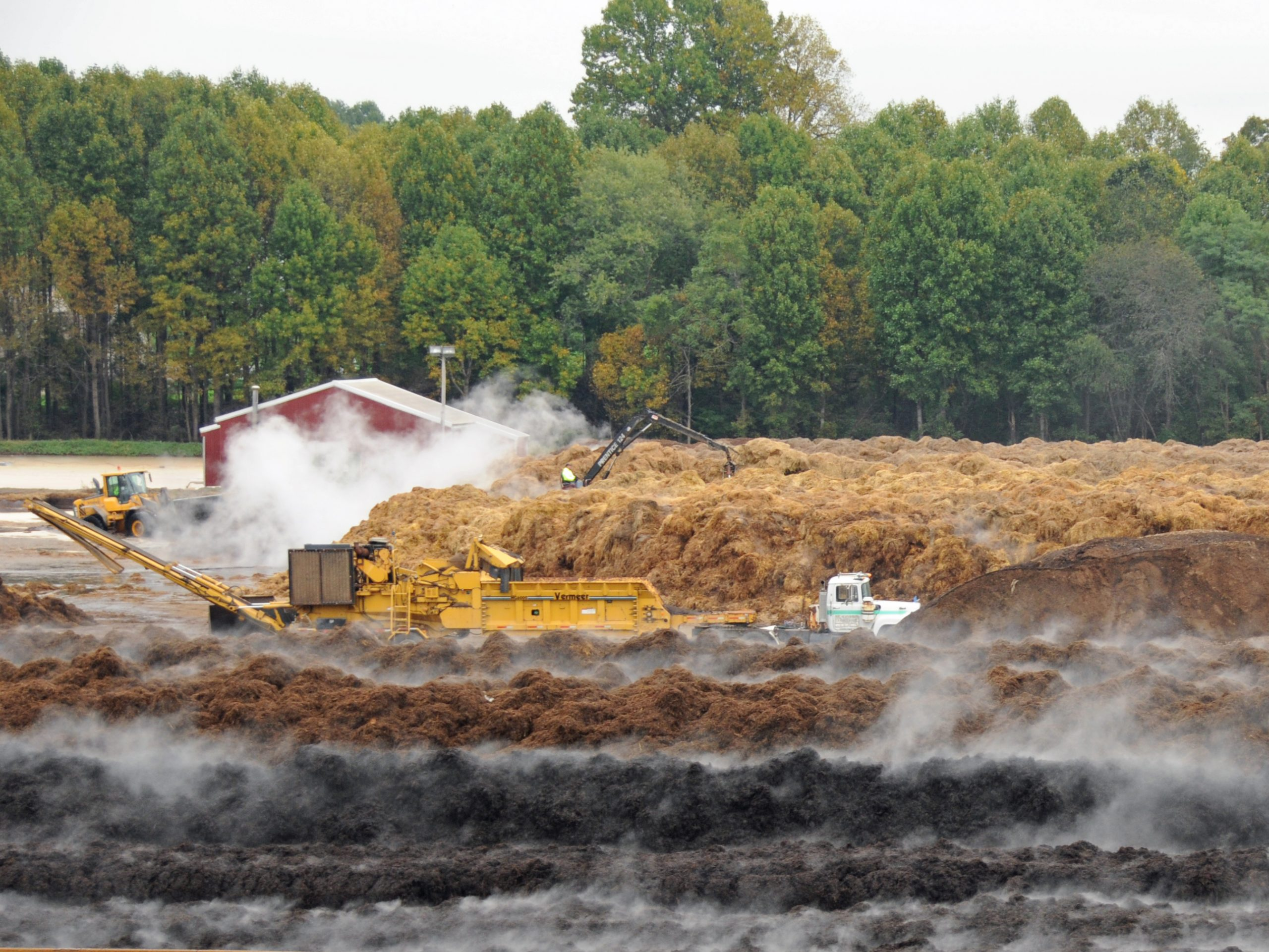 At an industrial compost facility that supplies the mushroom industry in Kennett Square, ground-up corn cobs are mixed with chicken manure, hay, cocoa shells and horse manure. Over time, growers have learned that mushrooms grow best with this blend of nutrients.