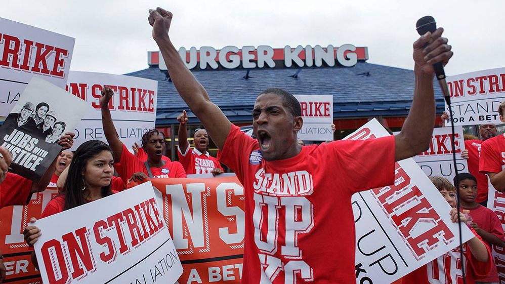 """""""Walking off the job, you're taking on your boss head-on, and that sounds like some pretty scary stuff, right?"""" says fast-food worker Terrence Wise, shown here at a 2013 strike in Kansas City, Mo. """"But I always thought, what am I more afraid of? Taking on my boss or being homeless again with my three little girls?"""""""
