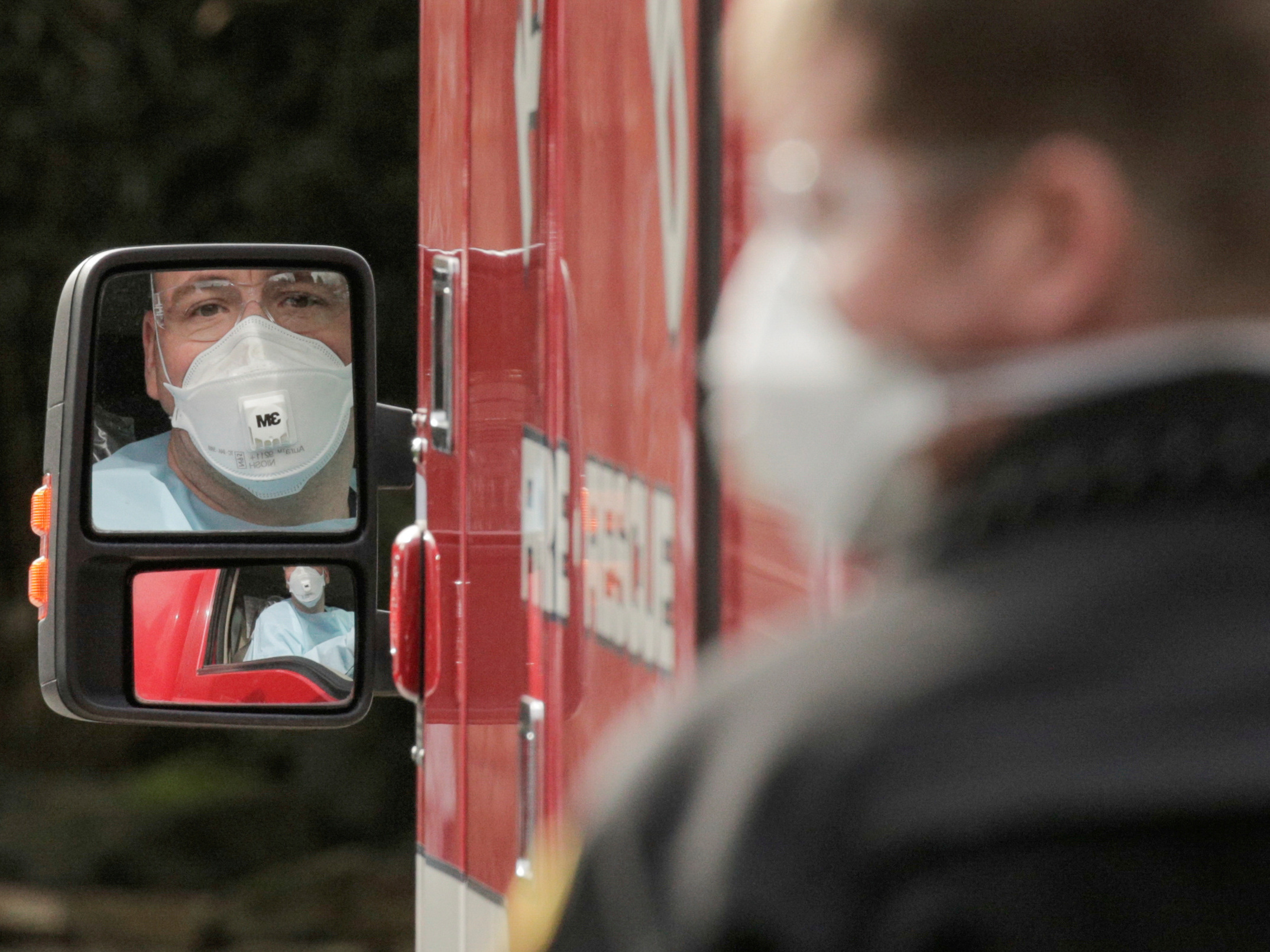 A medic drives an ambulance at the Life Care Center of Kirkland, Wash., which has been linked to most of the deaths in the U.S. from the coronavirus disease COVID-19 so far.