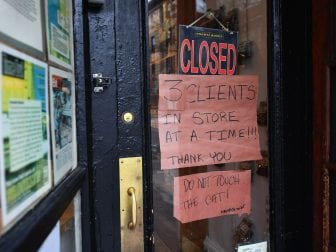 "A butcher shop in the Brooklyn borough of New York shows a ""Closed"" sign, limiting customers to three at a time. Gov. Andrew Cuomo is ordering all nonessential businesses to close, in an escalation of the state's attempts to contain the COVID-19 pandemic."